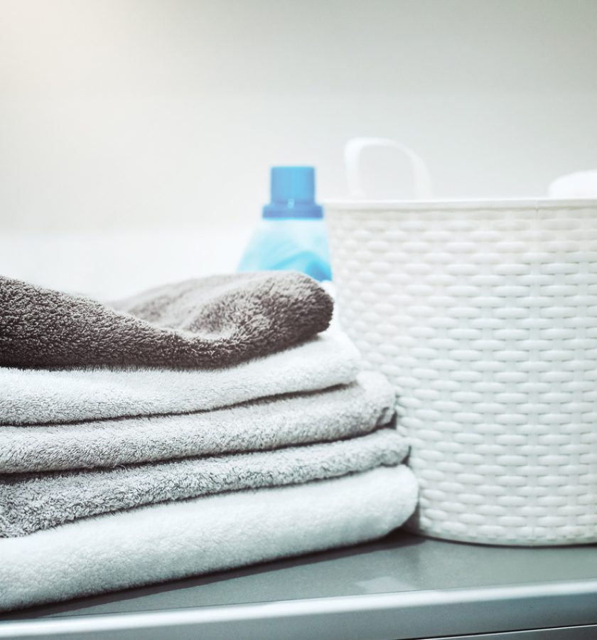 Still life shot of linen and a laundry basket on a washing machine